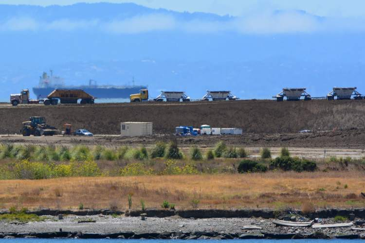 Richard Bangert &nbsp&nbsp Trucks are delivering soil to the western end of Alameda Point to stabilize the shoreline, one more step toward creating a recreational area.