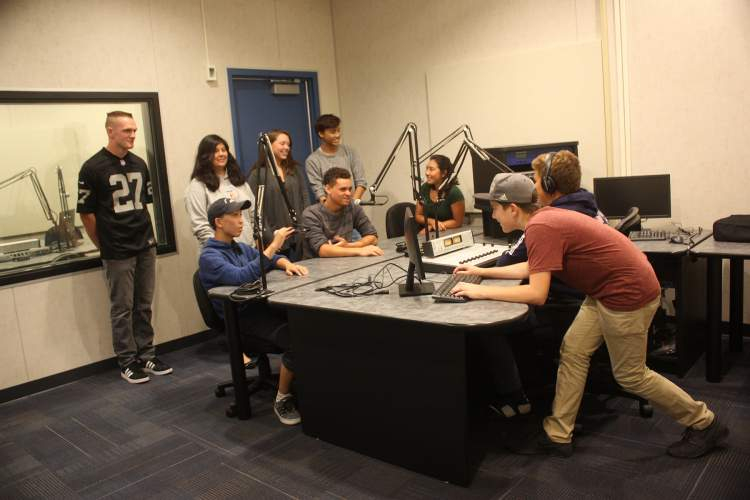 Dennis Evanosky  Encinal High School students gather in their brand-new radio studio. They plan to begin broadcasting a live news program and other content in November.