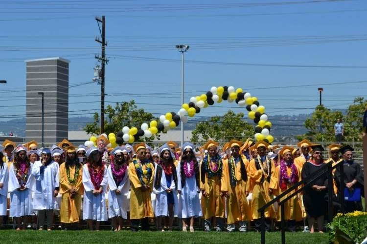 Courtesy photo - Members of the graduating class of Alameda High School await the reception of their diplomas June 12.