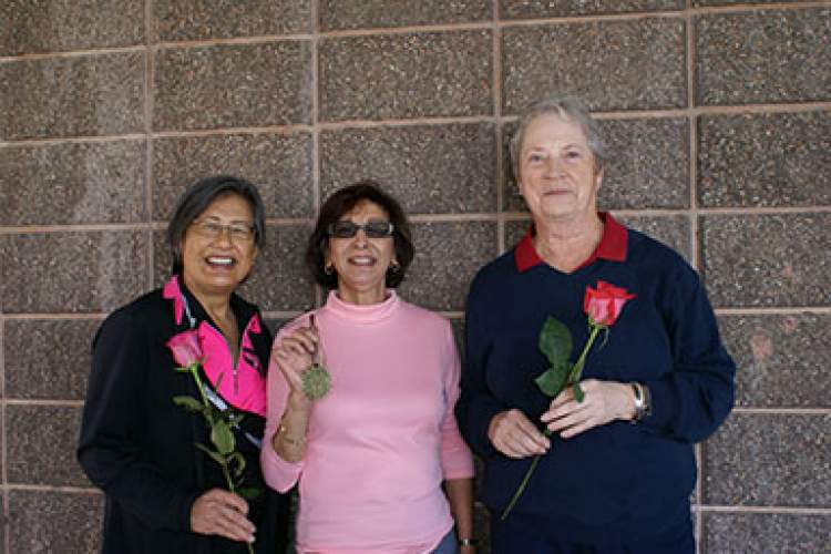 Assistant Captain Judy Eng (left) and Captain Diane Hughes (right) hold roses given to lady players by course management in observance of Valentine's Day. Juanita Solano (center) holds the medallion she was awarded by the Pacific Womens Golf Association Feb. 11 for being the most improved 18-hole golfer in the East Bay Area for the year 2013. Courtesy photo