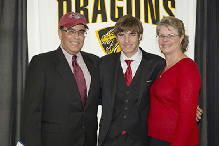 Andrew Melendez takes a moment with his parents after signing his letter of intent.  Regina Hamilton