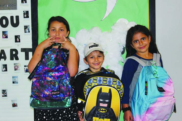 """Photo courtesy Alameda Boys & Girls Club &nbsp&nbsp Students from the Alameda Boys & Girls Club show off their backpacks from the 2017 """"Equipped 4 Success"""" school supply drive."""