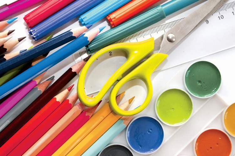 Courtesy photos &nbsp&nbsp The tools of the trade. Inset: Local kids show off their new art kits.