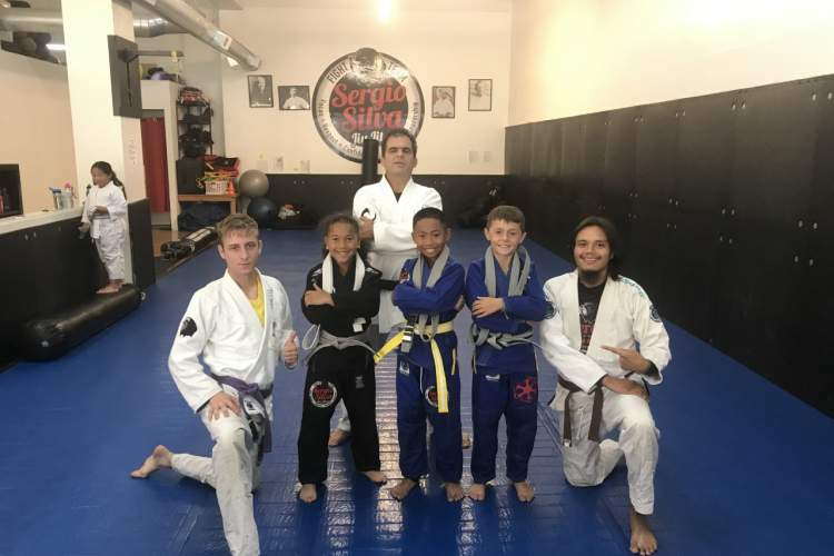 Courtesy photo &nbsp&nbsp Sergio Silva (back row) posed with students and instructors from his Park Street studio. Silva helped host the Jiu-Jitsu by the Bay Tournament in Alameda.