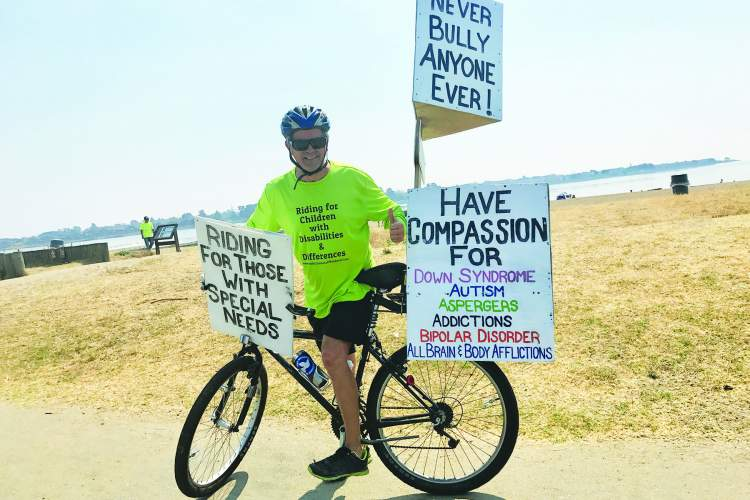 Courtesy photo.  Ohio native Bob Votruba has been cycling the West Coast on a quest to raise awareness of disabilities that plague children. Here he pauses at Crown Beach.