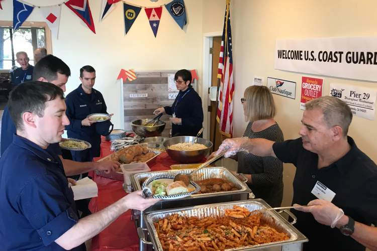 Sally Robinson &nbsp&nbsp Members of the U.S. Coast Guard, whose paychecks have been put on hold during the federal government shutdown received a free lunch courtesy of the Ballena Bay Yacht Club and its members.