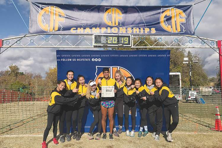 Courtesy Photo &nbsp&nbsp For Thanksgiving weekend at the Cross County State Championship in Fresno, the forecast called for heavy rain. Above, the Alameda High School Varsity qualifiers made sure the Alameda Sun was shining instead.