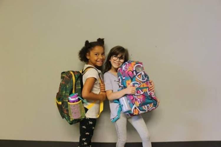 Courtesy Alameda Boys & Girls Club &nbsp&nbsp Students from the Alameda Boys & Girls Club show off their backpacks from the 2018 drive.