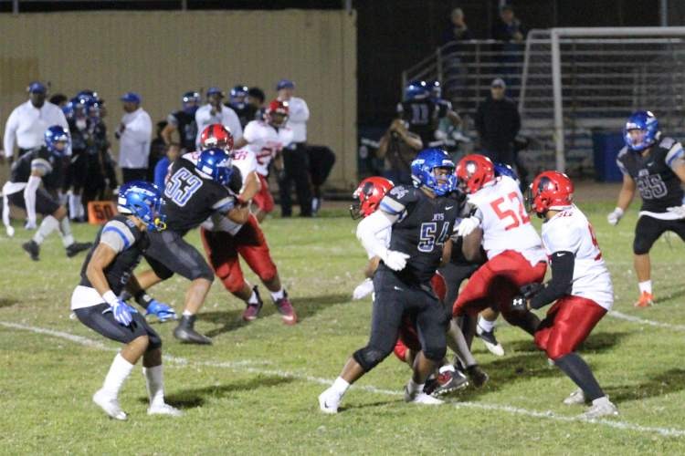 EHS Junior Shady Aboughanem &nbsp&nbsp Encinal High School junior Siave Pedro holds back the Titans defensive line for the Jets in last Friday's game.
