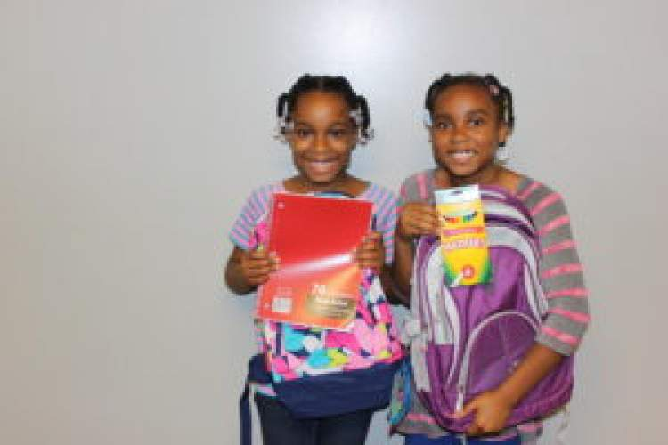 Courtesy photo &nbsp&nbsp These two Alameda youngsters seem pleased with the donations they received from AEF.