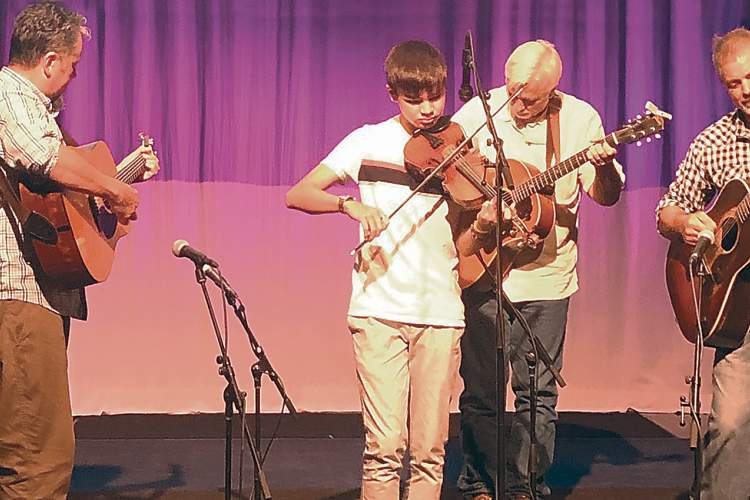 GMFC Photo &nbsp&nbsp Grand Master Fiddler Youth Championship winner Miles Quale of Alameda plays in the championship at the Country Music Hall of Fame and Museum.