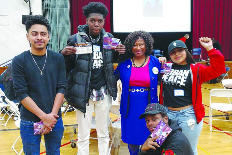 "Gabrielle ""Gaby"" Dolphin &nbsp&nbsp Left to right, Encinal High School students Jonathan Hernandez, Ronnie Coleman, Veronica Canas and Reinhart Nderitu (kneeling) surround Civil Rights Attorney Pamela Price. They represent the ""Political and Proud"" at a Feb. 21 event designed to get young people energized and involved in the political process."