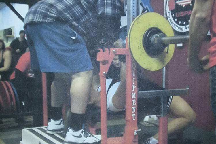 Courtesy photo Bettina Lutman performs a successful lift while coach Art Ramsey spots at the Pacific Coast Open Powerlifting Championship last month in Vacaville.