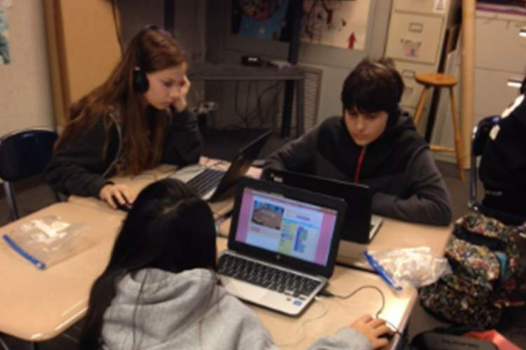 Alameda Unified School District  Students at Lincoln Middle School concentrate on coding during Computer Science Education Week earlier this month.