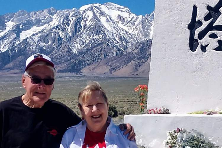 Courtesy photo &nbsp&nbsp Susanne La Faver (right) and husband Lyle didn't forget their favorite local newspaper while on a pilgrimage to the National Historic Site, Manzanar, Calif., last month.