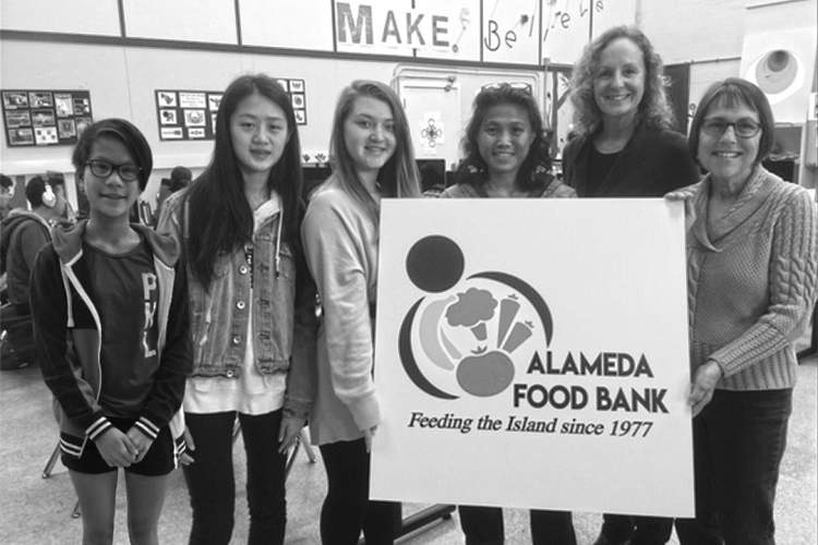 Courtesy Alameda Food Bank &nbsp&nbsp From left, students: Janine Barot, Hailey Jiang and Talia Grumet; and instructor Andrea Szeto along with Alameda Food Bank's Rebecca Rivkyn and Cindy Houts celebrate the students' work on the new logo for the Alameda Food Bank.