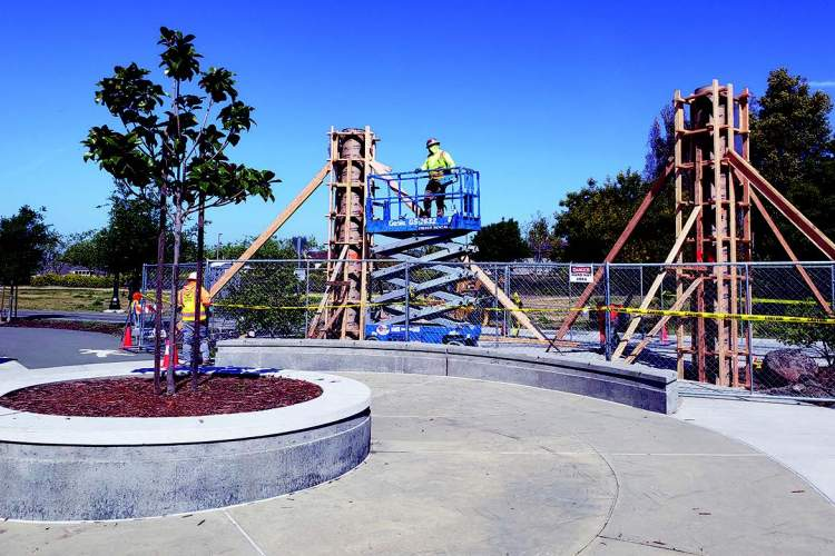 "Work crews began installing ""Gateway Columns,"" public art by Norman Moore, at Jean Sweeney Open Space Park last week."