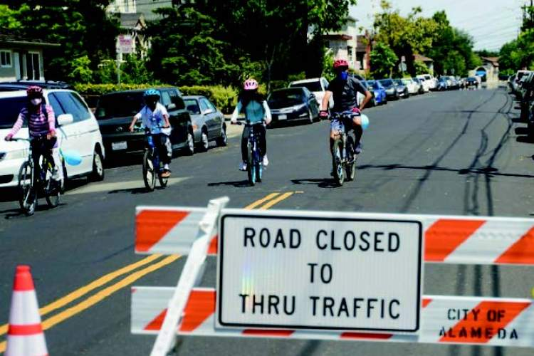 """During the pandemic, the city blocked 4.7 miles of """"Slow Streets"""" to through automobile traffic to provide more space for physical activity at a distance. Officials invite you to help decide what's next for the Slow Streets program at next Monday's open house."""
