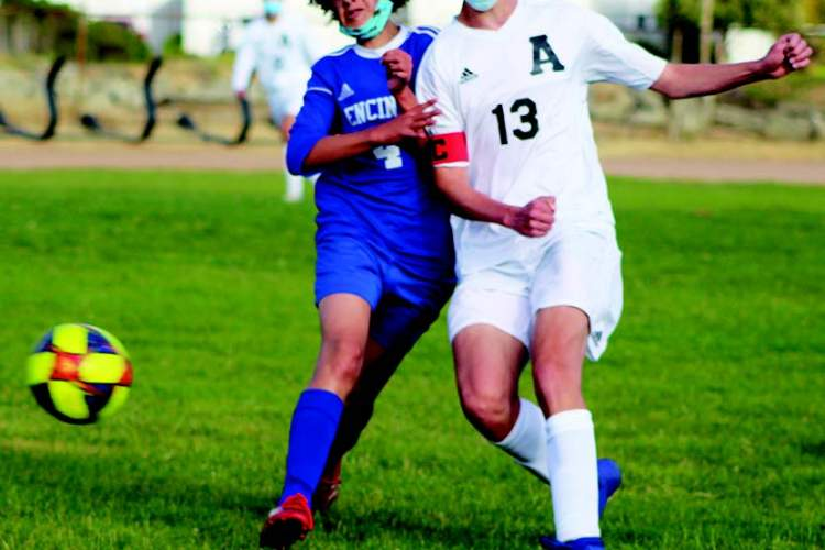 Photo & story by Rafael Arredondo  Encinal sophomore Soral Richardson battles for position against Alameda High School's Quinn Dooley.