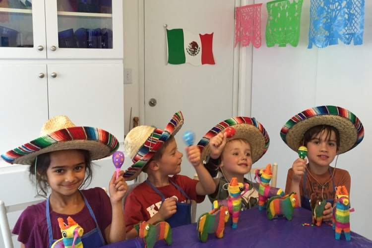 Robin Seeley  Culinary Institute of Post Street's students Leila, Enzo, Julian and Roan show off their piñata cookies, maracas, real mini piñatas and new-found appreciation for Cinco de Mayo.