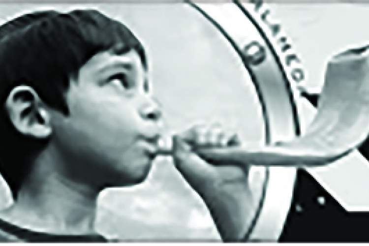 Courtesy photo &nbsp&nbsp A child demonstrates how to play the shofar.