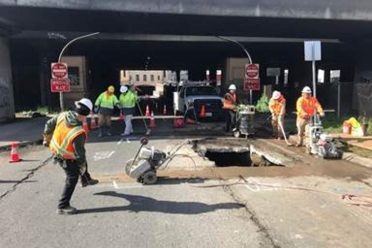 City of Alameda &nbsp&nbsp A city of Oakland Public Works crew works to fill the sinkhole and repair the pavement just outside the exit of the Posey Tube Monday.
