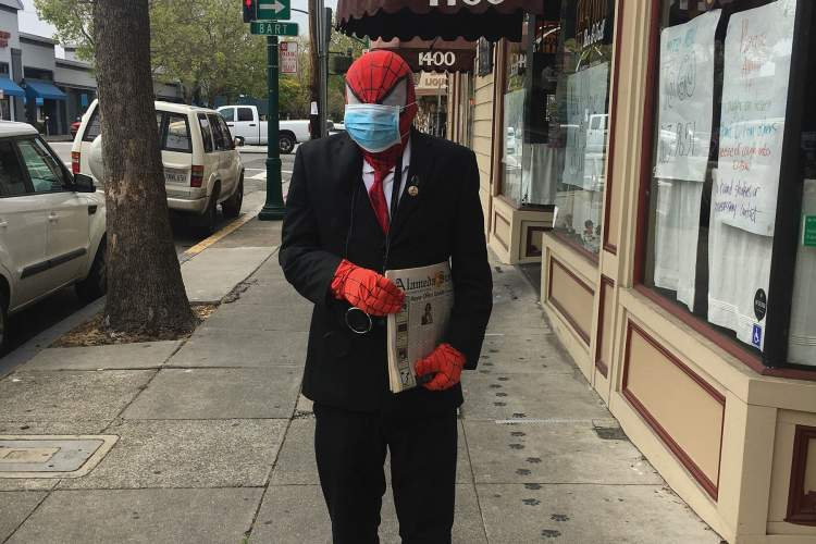 """Spider-Man was spotted Saturday on Webster Street, personally delivering the Alameda Sun to readers, practicing social distancing by using his web shooters to give out copies, and encouraging the use of masks. """"I've been wearing a mask since 1963, and all of a sudden it's a thing."""""""