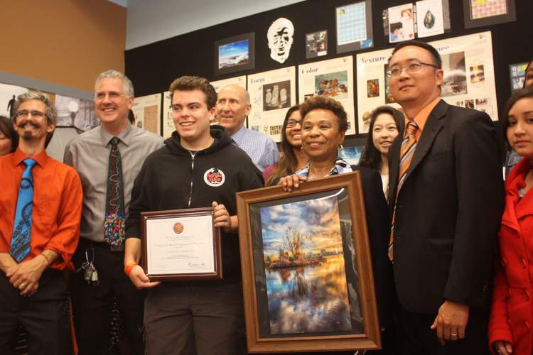 Photo by Dennis Evanosky - Saint Joseph Notre Dame High School principal Simon Chiu and senior Taylor Griffith flank Congresswoman Barbara Lee. Lee visited the high school to present Griffith with a Congressional award for his artwork.