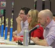 Judges Eric J. Kos and Julia Park Tracey with Head Speller Michael Jonas.