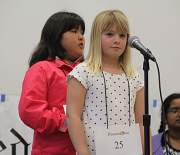 Spellers lined up two at a time at the mic.