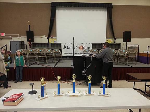 Chuck Kapelke sets up, trophies - Photo by Eric J. Kos