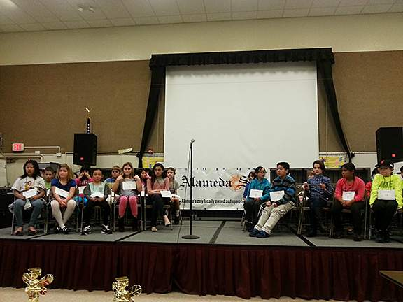The 31 semifinalists take their seats. Spellers were seated in alphabetical order. Photo by Eric J. Kos