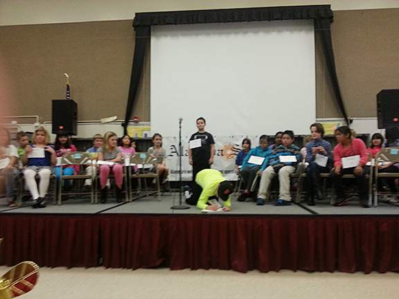 Spellers were allowed a chance to write out the word to help them find the correct spelling. Photo by Eric J. Kos