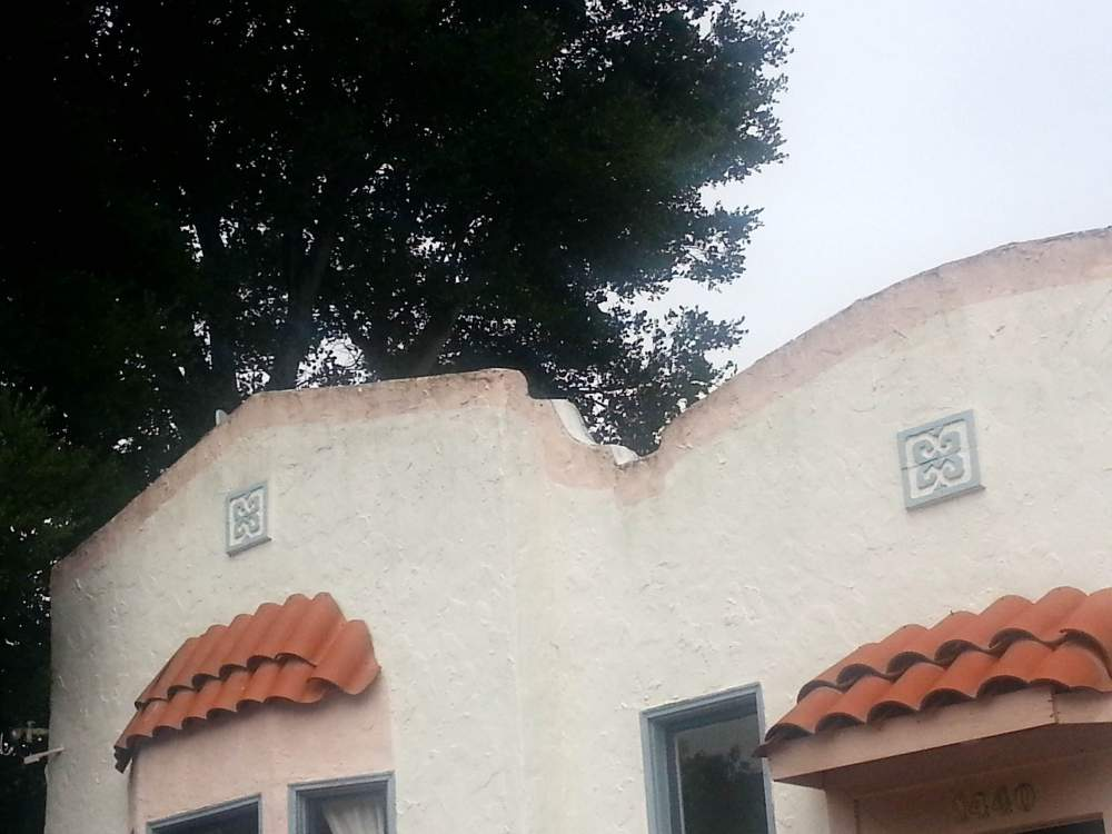 One in a series of photos of rooftops in Alameda, CA by Eric J. Kos
