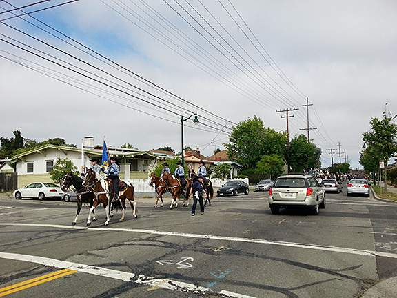 The Alameda County Sherriff's Mounted Posse marches down Buena Vista Avenue on its way to the parade route starting point.