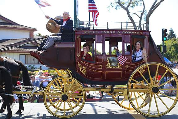 Parade Grand Marshal Jim Sweeney rode shotgun in the Wells Fargo stagecoach. Photo by Kevin Francis Barrett