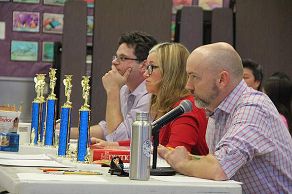 Judges Eric J. Kos and Julia Park Tracey with Head Speller Michael Jonas.