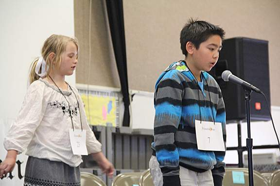And the field narrowed to the final two spellers: Hazel Purins (left) and Brenden Dalipe.