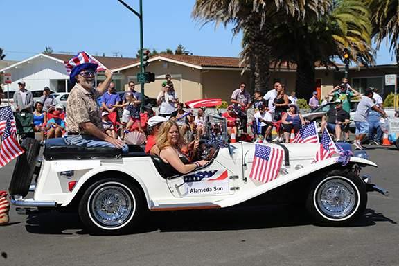 Photo by Kevin Francis Barrett - Alameda Sun Publisher Dennis Evanosky in the Sun's sponsormobile
