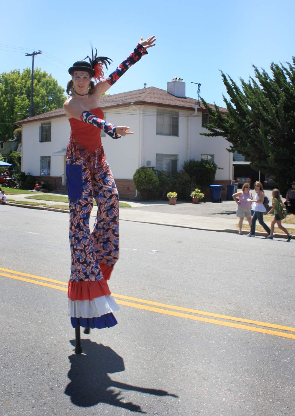 A stilt walker from Alameda Natural Grocery