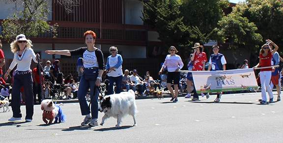The Friends of the Alameda Animal Shelter marched with their famous red white and blue doggy. Photo by JoanAnn Radu Sinaiko