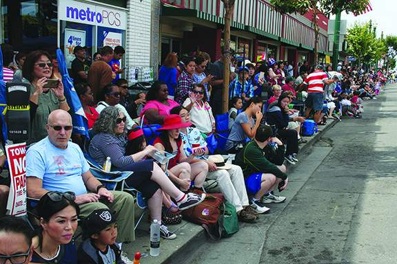 Spectators mass along Park Street. Photo by Mike Lano.