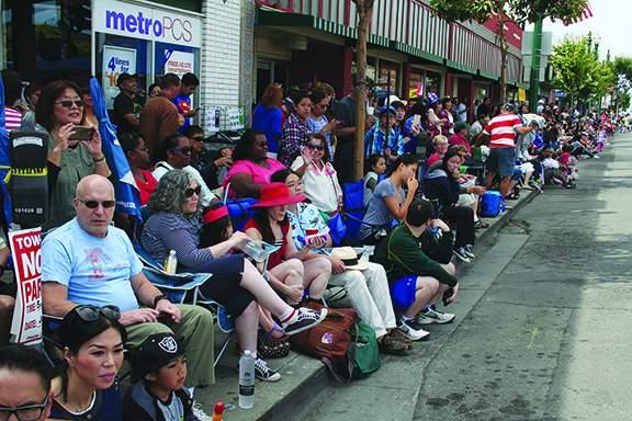 Spectators mass along Park Street. Photo by Mike Lano.