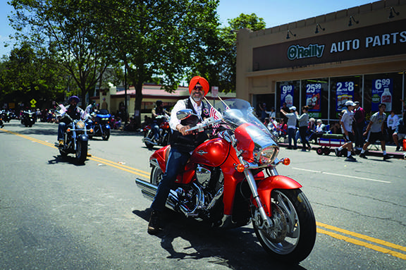 The Sikh Riders of America thrilled the crowd near Webster Street.