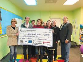 Courtesy photo &nbsp&nbsp  Local officials celebrated a donation to Haight Elementary School teacher Melissa Saunders recently.