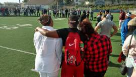 Oakland Unified School District  Antwaun Williams was murdered in Alameda last Saturday. His fellow students at Oakland High School ringed the school's football field to remember him. His mother, Monique, on the left in the white blouse, spoke to the students.