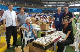 Negros Oriental Chinese Chamber of Commerce President Eduard Du (left) acted as liaison between the province, city and the mission delegation with ASCA Vice President Cynthia Bonta (seated in blue) and other medical mission volunteers at the outpatient staging area.