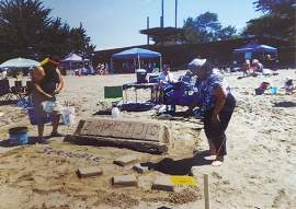 Courtesy photo. The Valerio family's Scrabble-themed sand sculpture graces the page for June which coincides with Alameda's annual Sand Castle and Sculpture Contest.