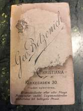 """Photos courtesy the Hughes family &nbsp&nbsp&nbsp The back of the photo (3) tells us that Danish-born photographer Georg Betzonich took the picture at his studio at Kirkegaden 30 in Oslo, Norway (Christiana was Olso's name from 1624 to 1925).  Pladen obevares means """"negative stored""""; so someone could easily visit the studio and get another copy from the photographer. The phrase on the bottom means that Betzonich used bromide paper to create the best results at the lowest price."""