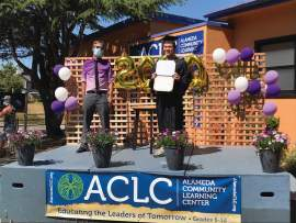 Yap family &nbsp&nbsp ACLC Principal Michael McCaffrey, left, presents graduate Quinton Yap with his diploma from the prescribed social distance.